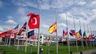 NATO'DA BAYRAKLAR YARIYA İNDİ