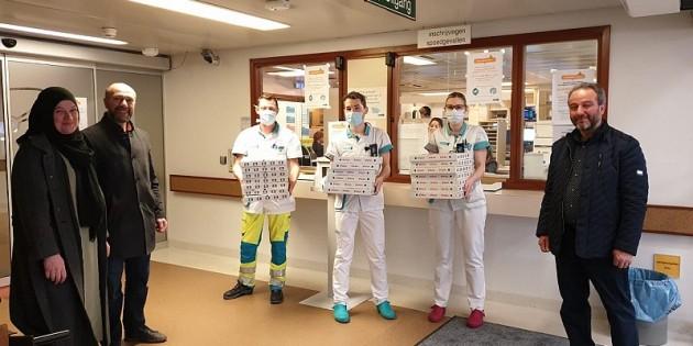 BİF Genk teşkilatından kahramanlara pizza ikramı