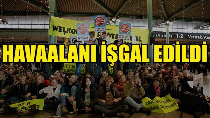 Hollanda'da iklim protestocuları havaalanını işgal etti